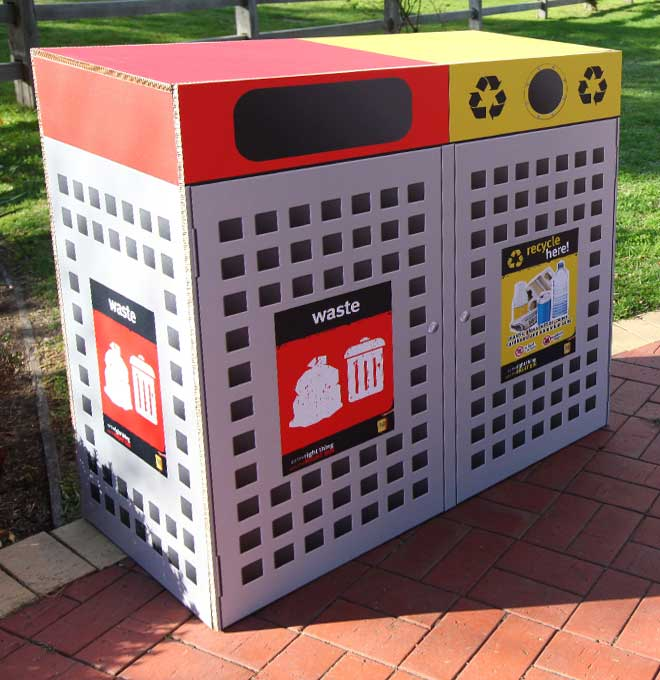 Custom made display featuring lifesize recycling bins created from X-Board.