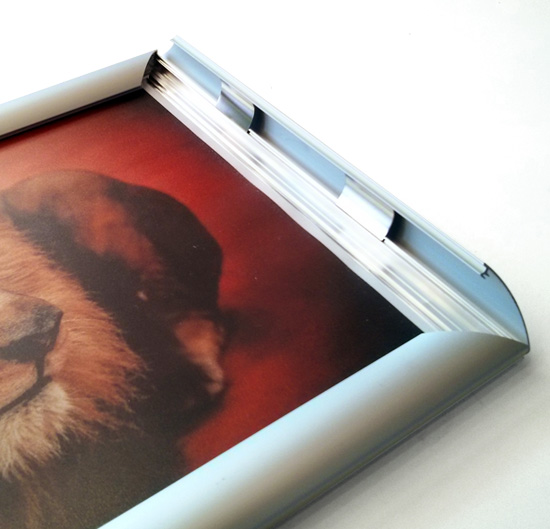Snapframe poster mounting system from Wild Digital. Image shows front opening hinge.