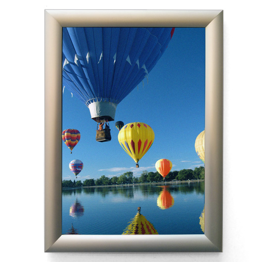 Snapframe poster mounting display from Wild Digital containing a poster of hot air balloons.